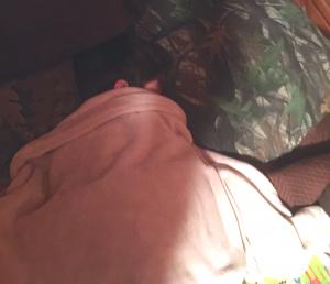 Hunter asleep at deer camp.